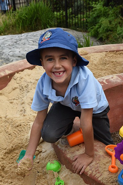 Student playing in the sandpit